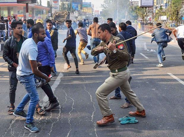 Police cane protesters protesting the Citizenship Amendment 2019 in Guwahati
