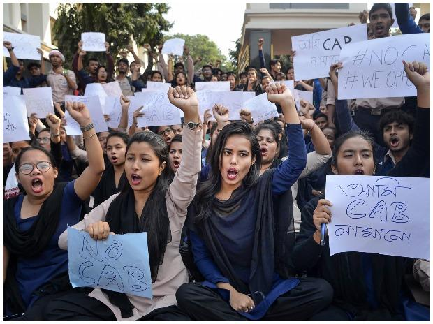 College students raise slogans in protest during a strike in Guwahati
