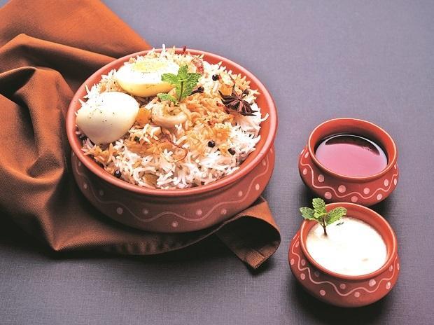 Egg biriyani served with raita