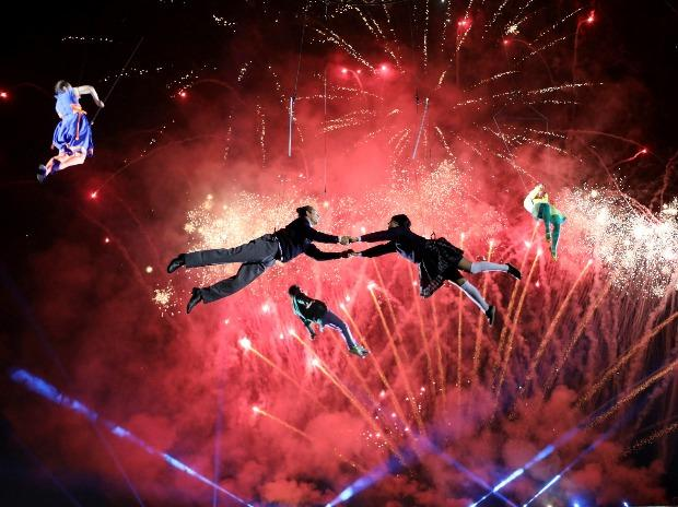 Artists perform during a mapping and pyrotechnics show coined Isidro's Dream as part of Christmas events at Bolivar square in Bogota, Colombia.