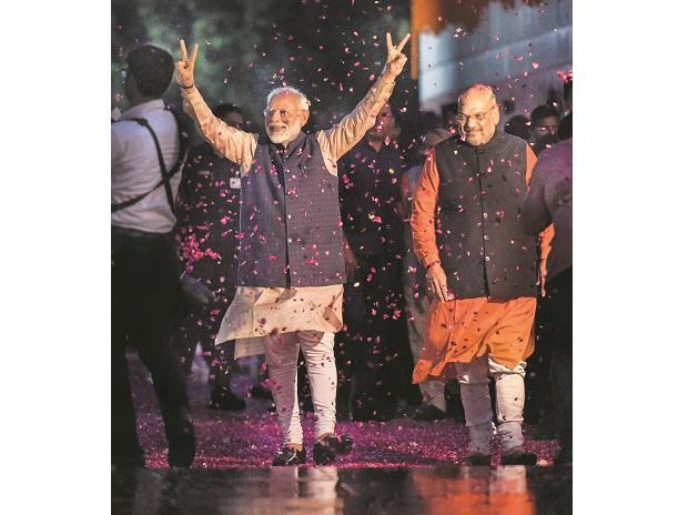Modi storms back to power