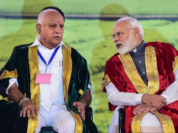 Prime Minister Narendra Modi launches the I-STEM portal as Science and Technology Minister Harsh Vardhan and Karnataka Chief Minister B S Yediyurappa (L) look on, during the inauguration of 107th Indian Science Congress.