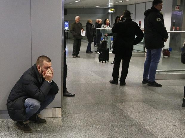 A relative of one of flight stewardesses, who were on the board a Ukrainian 737-800 plane, reacts at Borispil internation airport. Photo: AP/PTI