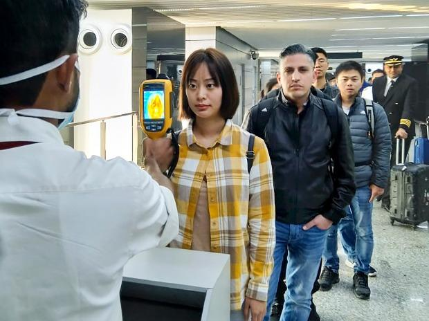 A thermal screeening device checks passengers arriving in India from China including Hong Kong in view of outbreak of Novel coronavirus (CoV) in China, at an airport in Kolkata