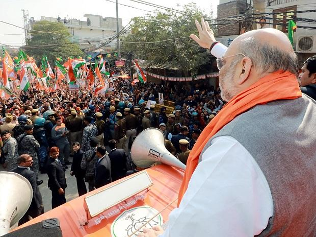 Union Home Minister Amit Shah during a roadshow ahead of Delhi assembly polls in New Delhi. Photo: ANI