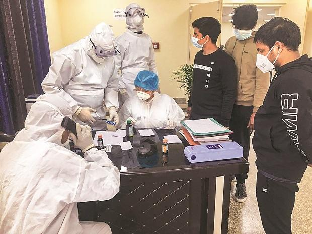 Indians, airlifted from Wuhan, undergo tests at a quarantine facility in New Delhi Photo: PTI