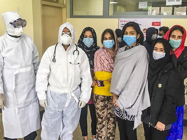 Indian nationals, airlifted from China's Wuhan, are seen inside a quarantine facility set by up ITBP IN New Delhi. Photo: PTI