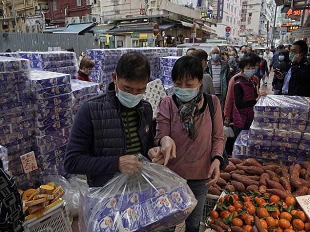 Hong Kong:  Customers wearing masks buy bath tissue papers at a store