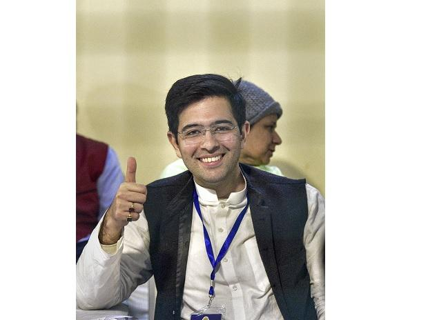 Aam Aadmi Party leader Raghav Chadha displays victory sign as early trends show party's victory in Delhi poll results. Photo: PTI