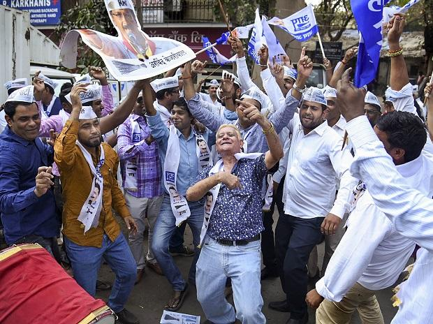 Aam Aadmi Party workers celebrate party's success in Delhi Assembly polls. Photo: PTI