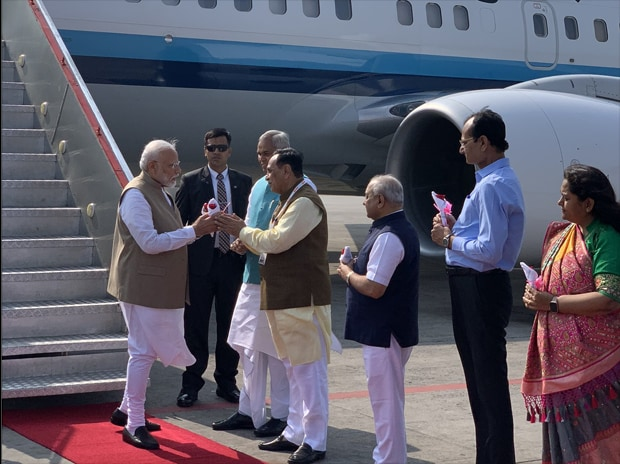 PM Narendra Modi is greeted by Gujarat Governor Acharya Devvrat, Chief Minister Vijay Rupani and Deputy Chief Minister Nitinbhai Patel on his arrival at airport