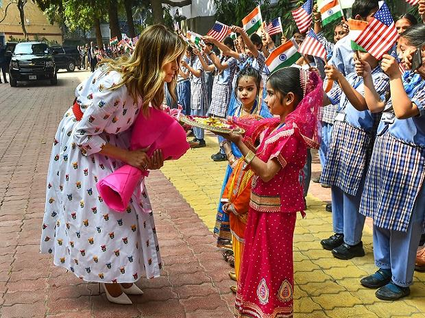 US First Lady Melania Trump being welcomed during her visit to a government school to witness various activities as part of the 'happiness curriculum', in New Delhi | PTI