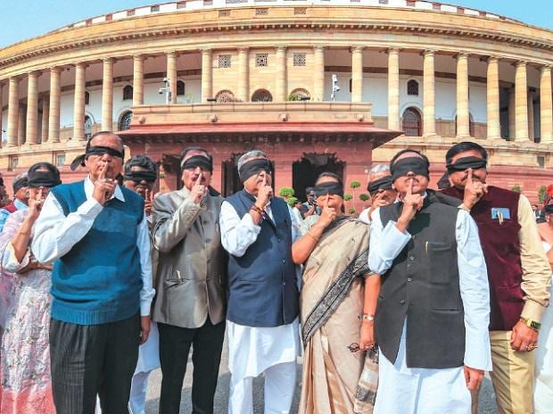 Trinamool Congress leaders raise a riot over Delhi violence during the ongoing Budget session in New Delhi. Photo: PTI