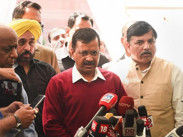 Delhi Chief Minister Arvind Kejriwal with Aam Aadmi Party (AAP) leader Sanjay Singh addresses media. Photo: PTI
