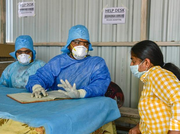 An Indian woman who recently returned from the United States being examined by doctors at a novel coronavirus help desk, at a hospital in Hyderabad