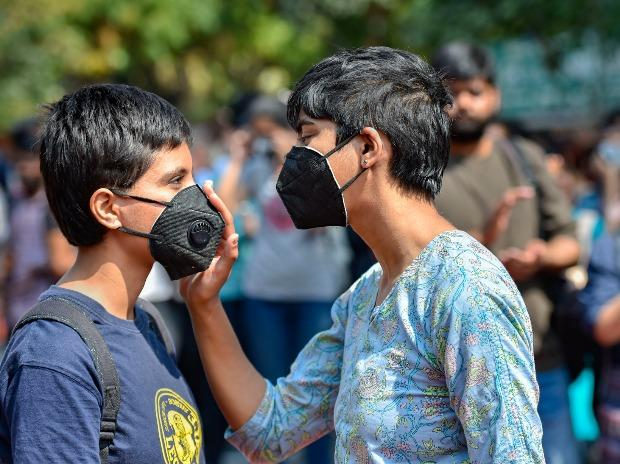 Students wearing protective masks participate in a demonstration 'Delhi Chalo' against Citizenship (Amendment) Act at Jantar Mantar in New Delhi
