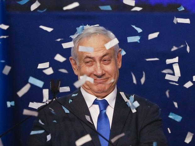 Israeli Prime Minister Benjamin Netanyahu smiles after first exit poll results for the Israeli elections at his party's headquarters in Tel Aviv. Photo: AP/PTI