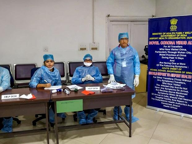Medics wearing protective suits wait for passengers to be screened at Lokpriya Gopinath Bordoloi International Airport in view of novel coronavirus outbreak, in Guwahati | PTI