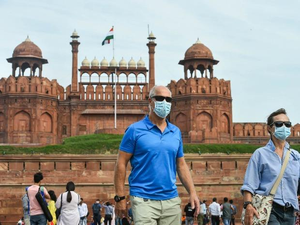 Visitors wear masks to mitigate the spread of coronavirus, at Red Fort in New Delhi