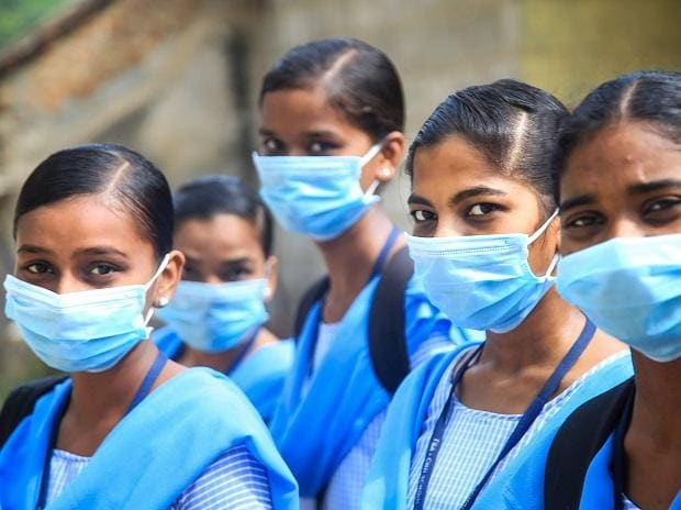Kanyakumari: Students wearing maks in the wake of coronavirus pandemic pose for a photograph at Nagercoil in Kanyakumari district, Thursday, March 19, 2020. (PTI Photo)