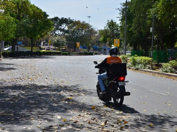 A food delivery professional rides through Connaught Place