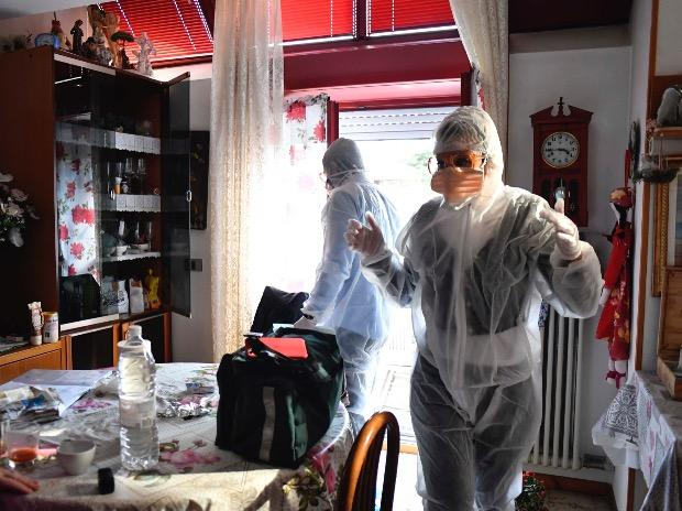 Medical staffers wearing protective gear, part of a special unit performing house calls, work in Bergamo, northern Italy, one of the areas worse-affected by coronavirus. Photo: PTI