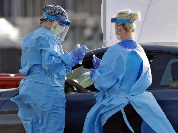 Medical personnel from BayCare test people for the coronavirus in the parking lot outside Raymond James Stadium in Tampa, Florida. Photo: PTI