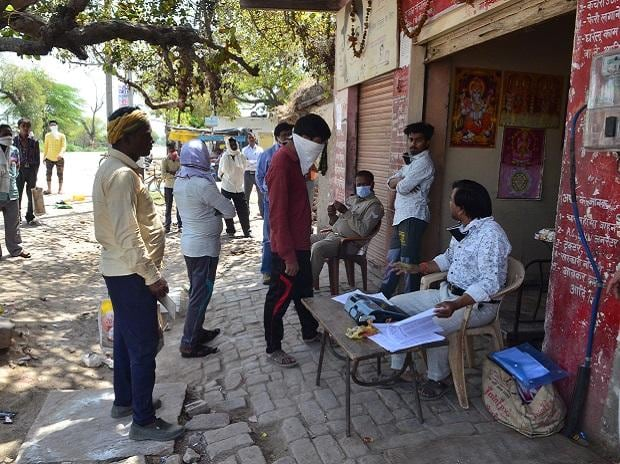 People queuing up in front of a ration shop to get their monthly quota | Photo: Sanjay K Sharma