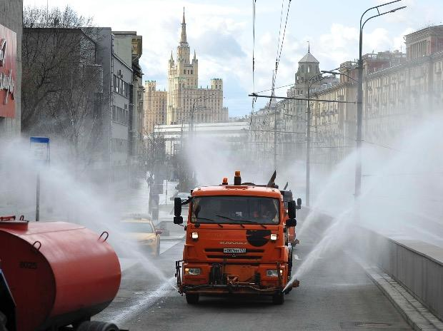 Municipal tankers spray disinfectant as a precaution against the coronavirus, on a street in Moscow, Russia. Photo: PTI