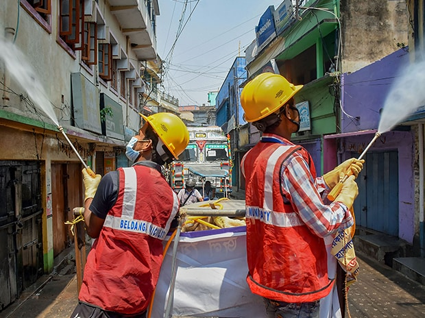 Municipal workers spray disinfectant in a residential locality during ongoing Covid-19 lockdown at Beldanga in Murshidabad district of West Bengal. Photo: PTI