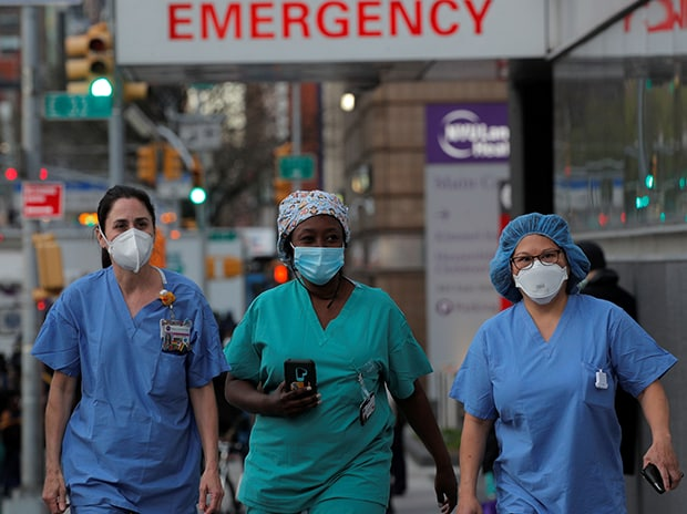 Healthcare workers walk outside NYU Langone Medical Center on 1st Avenue in Manhattan after people came to cheer and thank them, during Covid-19 outbreak in New York City.