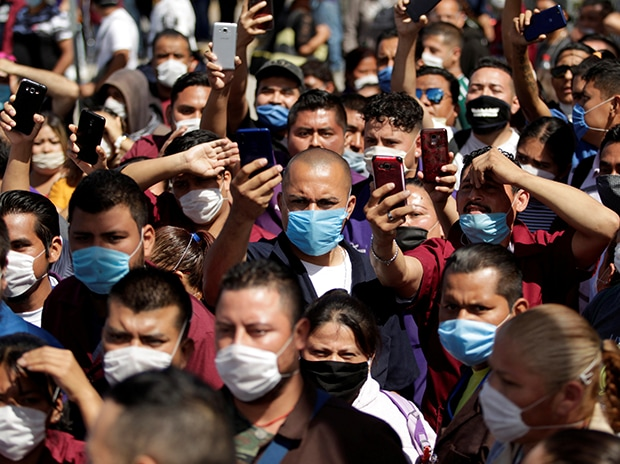 Employees of Electrocomponentes de Mexico are seen during a protest to halt work amid the spread of the coronavirus diseas, in Ciudad Juarez, Mexico. Photo: Reuters