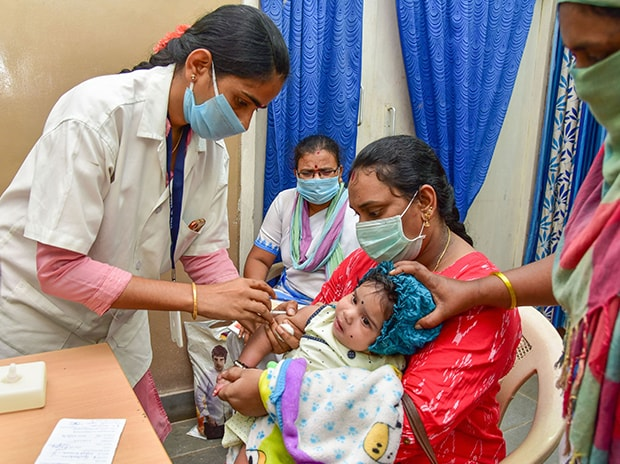 A child receives a general immunisation vaccine, during the nationwide lockdown in wake of the coronavirus pandemic, at a government hospital in Hyderabad. Photo