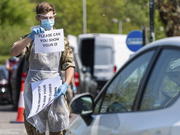 Torquay: In this undated handout photo issued by the Ministry of Defence on Monday, April 27, 2020, a royal marine is working at a Mobile Testing Unit in Salisbury to conduct COVID 19 testing, for NHS key workers,  in Torquay, England. AP/PTI