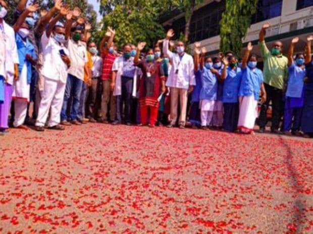 Indian Air Force helicopter showers flower petals over Trivandrum Medical College Hospital