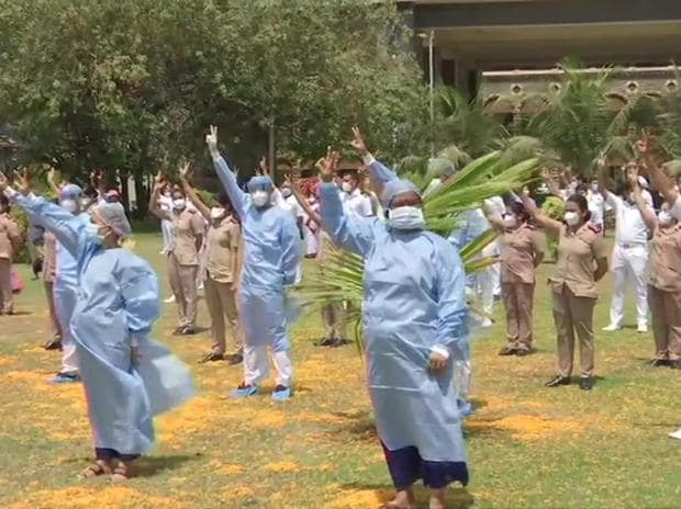Indian Air Force helicopter showers flowers on the staff of Indian Navy's INHS Asvini in Mumbai