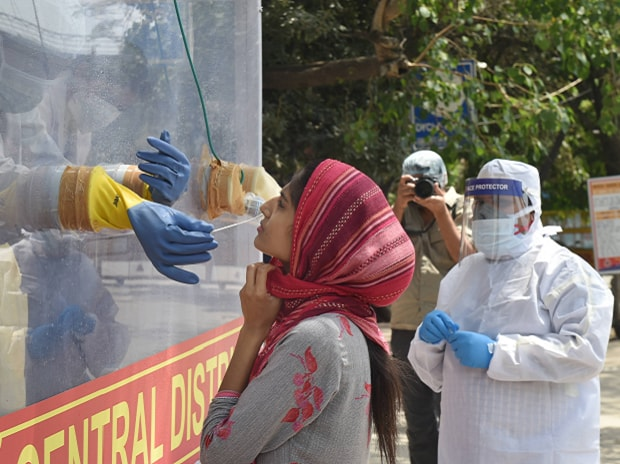 New Delhi: A medics collects samples for swab tests from a COVID-19 mobile testing van, during the nationwide lockdown to curb the spread of coronavirus, at Ramakrishna Mission area in New Delhi. (PTI Photo/Manvender Vashist)