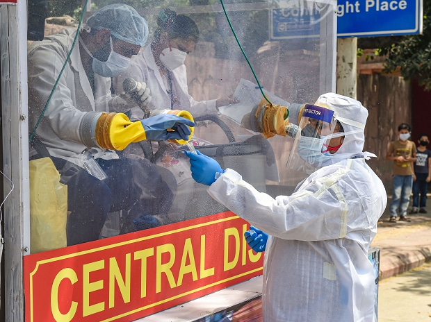 Medics prepare to collect samples for swab tests from a COVID-19 mobile testing van, during the nationwide lockdown to curb the spread of coronavirus, at Ramakrishna Mission area in New Delhi. (PTI Photo/Manvender Vashist)