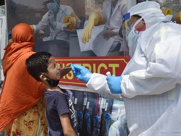 Medics collect samples for Covid-19 swab tests in New Delhi. Photo: PTI