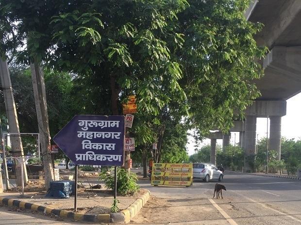 Empty roads near a sign board