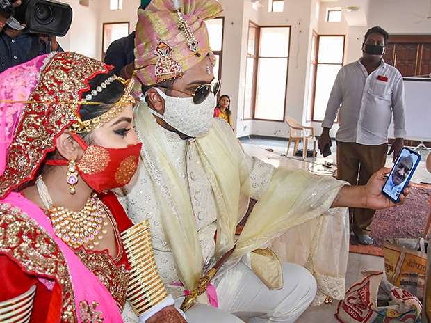 A couple, wearing face masks, gets married in Jodhpur, during the nationwide lockdown.