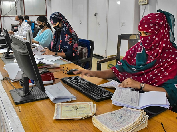 Employees of head post office resume work after Government offices opened with thirty per cent staff in attendance during the Covid-19 lockdown, in Jabalpur. Photo: PTI