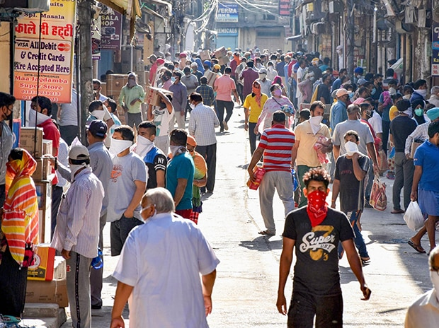 People carry various items after purchasing from a market, during the nationwide lockdown, in Jalandhar. Photo: PTI