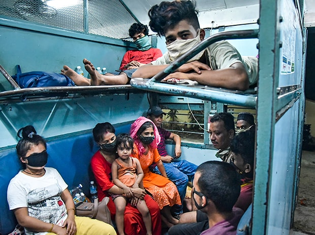Migrants travel towards their native places in northeast, during the ongoing Covid-19 nationwide lockdown, at Rayanapadu near Vijayawada. Photo: PTI