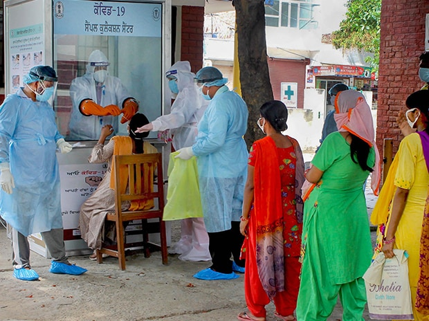 Medics take samples from pregnant women for Covid-19 swab tests, during the ongoing nationwide lockdown to curb the spread of coronavirus, in Patiala. Photo: PTI