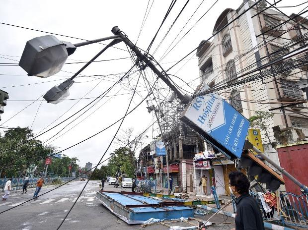 A damaged electrical pole lying on a road, in the aftermath of super cyclone 'Amphan', in Kolkata