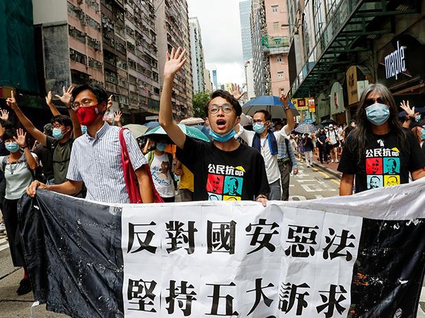 (L-R) Pan-democratic legislator Eddie Chu Hoi-dick, Vice convener for Hong Kong's Civil Human Rights Front Figo Chan, and activist Leung Kwok-hung, also known as