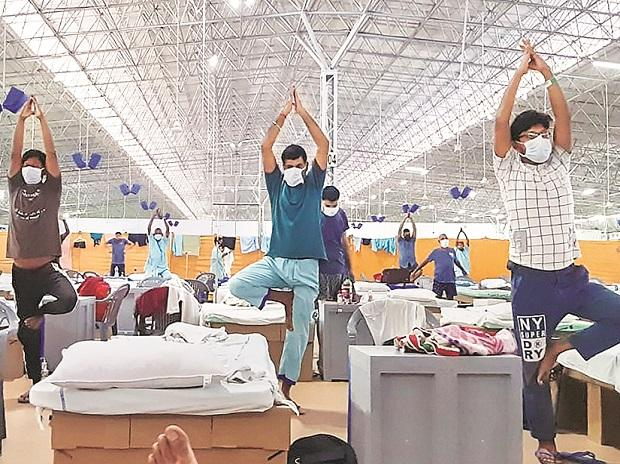 Patients attend the morning Yoga session, organised by the ITBP at Sardar Patel Covid Care Centre and Hospital in New Delhi 	pti