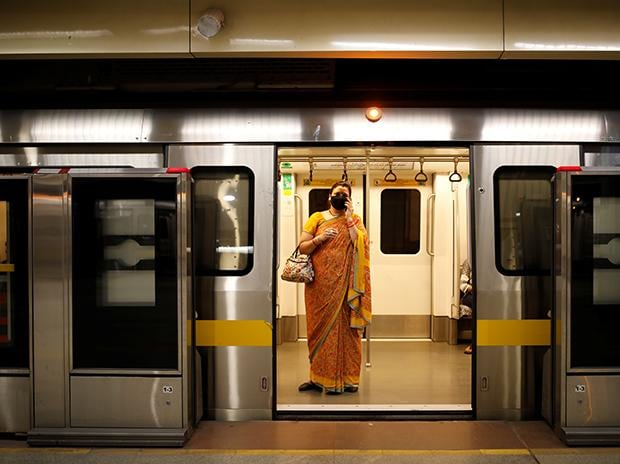 A passenger wearing face mask takes a train at a Delhi metro train station, on the first day of the restart of their operations, amidst the spread of coronavirus disease (COVID-19), in New Delhi. Photo: Reuters