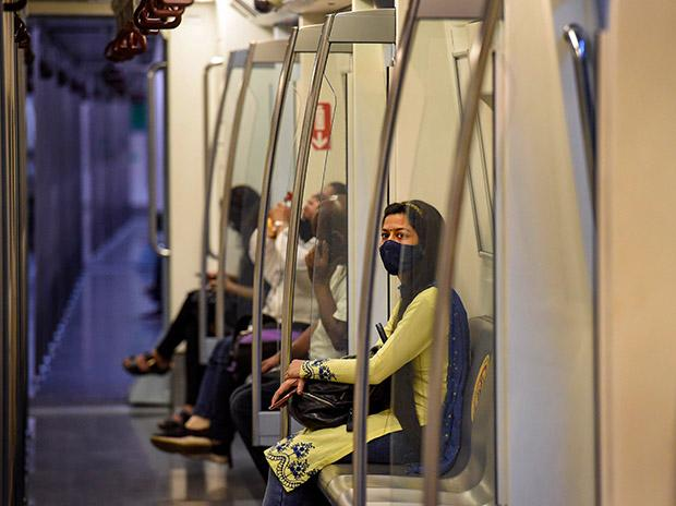 Commuters travel in a metro train after Delhi Metro resumed services with curtailed operation of the Yellow Line and Rapid Metro, amid the ongoing coronavirus pandemic, in New Delhi. Photo: PTI